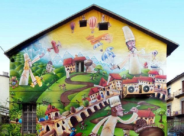 Граффити на стене кондитерской фабрики в Италии