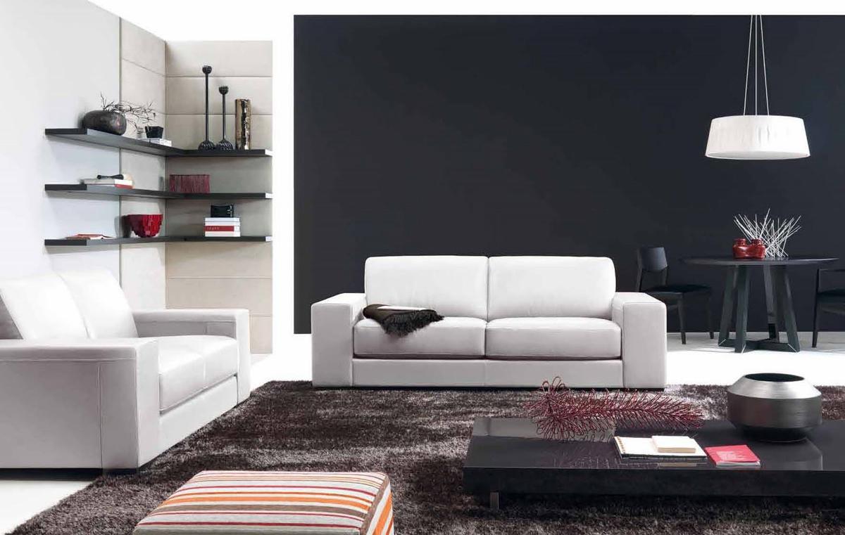 Увеличить глубину пространства гостиной поможет одна темная стена