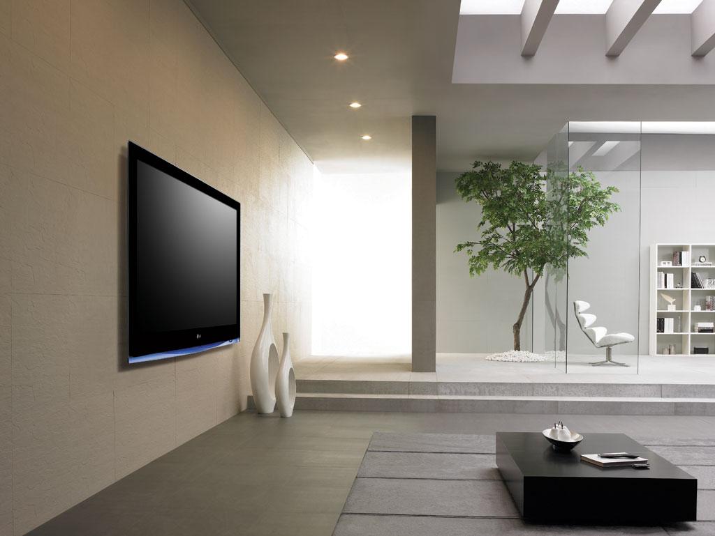 Пример увеличения длины гостиной с помощью яркого освещения и оригинальной комбинации освещения